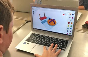 Student engaged in Tinkercad design